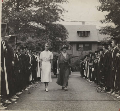 Mary Woolley being escorted by Sarah Cole '37 through members of the Class of 1937 during the Centennial Celebration