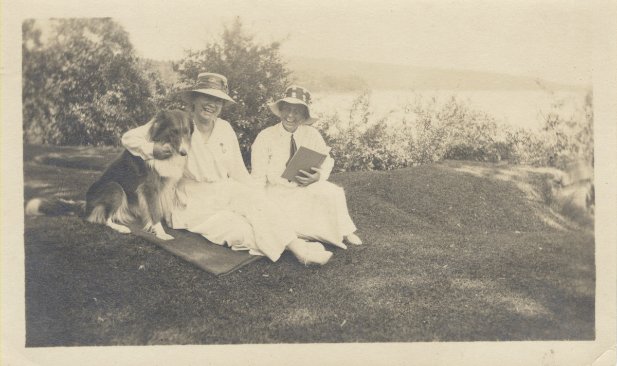 Mary Woolley and Jeannette Marks seated on a hill