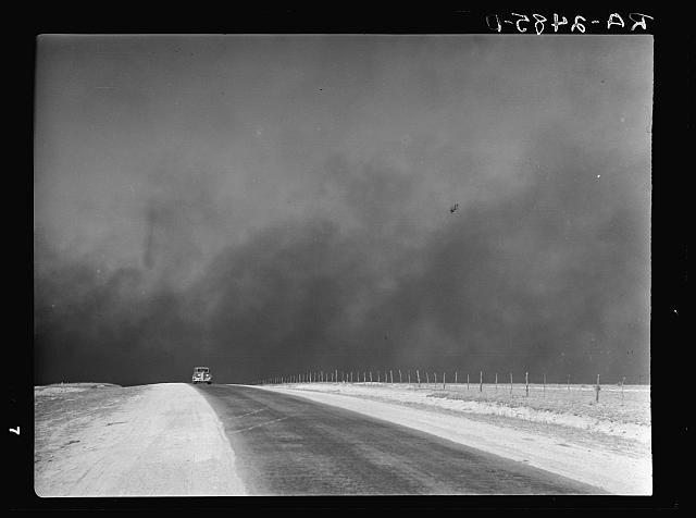 Car with dust storm approaching, March, 1936