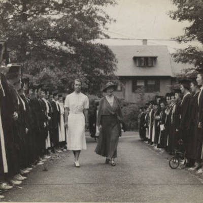 Sarah_Cole_class_of_1937_escorting_Mary_E_Woolley_through_members_of_the_class_of_1937_at_an_Honorary_ceremony.jpg