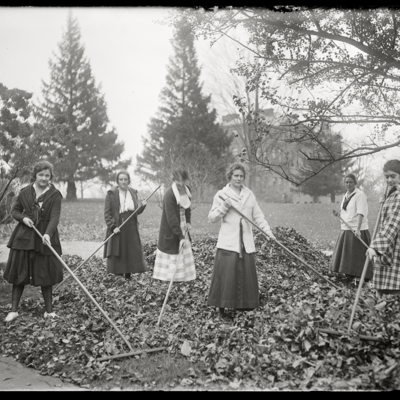 Student groups 1920s raking leaves